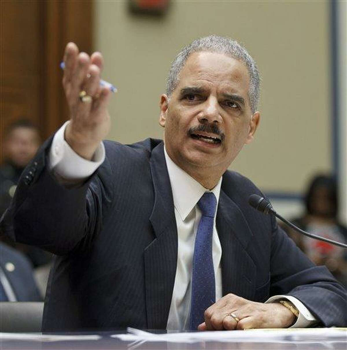 Attorney General Eric Holder testifies on Capitol Hill in Washington today before the House Oversight and Government Reform Committee. Associated Press