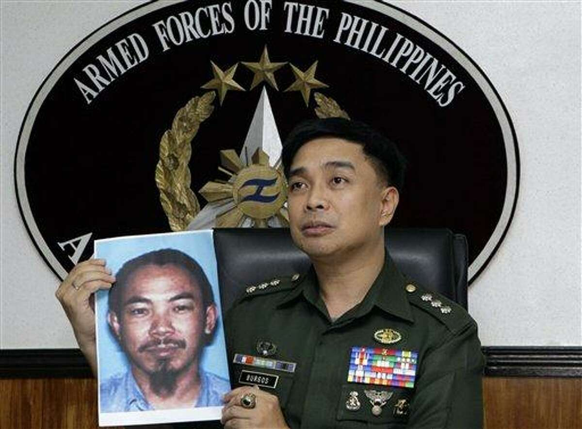 Armed Forces of the Philippines spokesman Col. Marcelo Burgos shows a picture of Malaysian Zulkipli bin Hir, also known as Marwan, a top leader of the regional, al Qaida-linked Jemaah Islamiyah terror network, during a press conference today in suburban Quezon City, north of Manila, Philippines. The military said it killed Southeast Asia's most-wanted terrorist and two other senior militants in a U.S.-backed airstrike that would mark one of the region's biggest anti-terror successes in recent years. Associated Press