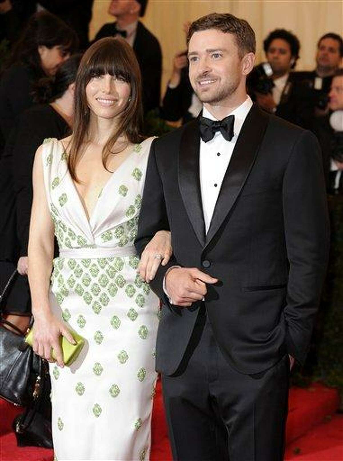 In this May 7, 2012, file photo, Jessica Biel and Justin Timberlake arrive at the Metropolitan Museum of Art Costume Institute gala benefit, celebrating Elsa Schiaparelli and Miuccia Prada in New York. Biel says that before Timberlake proposed, she didn't expect to ever get married. The 30-year-old actress told The Associated Press on Friday that she feels