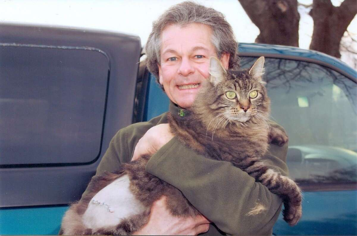 Vietnam era veteran Brian Sullivan holds his cat, Rocco, after the cat received needed surgery from the Torrington Animal Hospital. (Submitted photo)