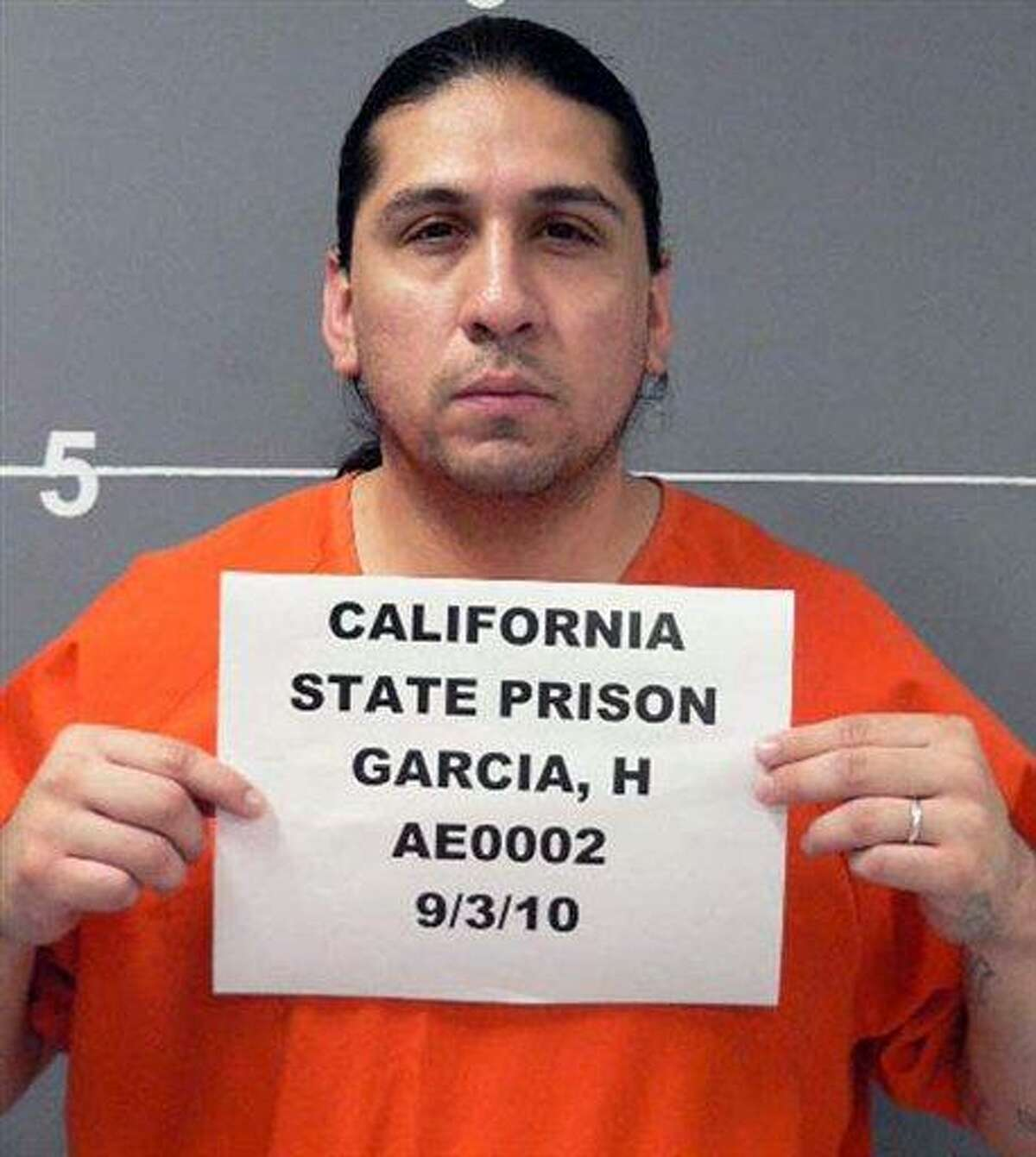 A Sept. 3, 2010 photo provided by the California Department Of Corrections shows Hector Garcia Jr. Garcia used a smuggled smart phone hidden in his cell at Kern Valley State Prison to rally support on Facebook for an inmate hunger strike this summer that sought improved living conditions for gang leaders housed in special secure cellblocks. (AP photo/California Department Of Corrections)