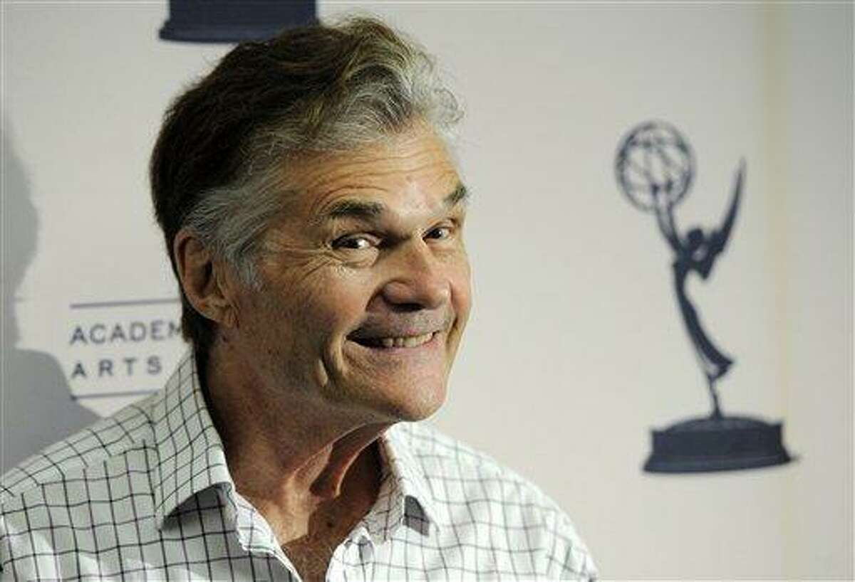 In this Aug. 22, 2011 file photo, actor Fred Willard poses at a cocktail reception for The Academy of Television Arts & Sciences' Performers Peer Group in Los Angeles. Willard said his recent lewd conduct arrest at an adult movie theater was