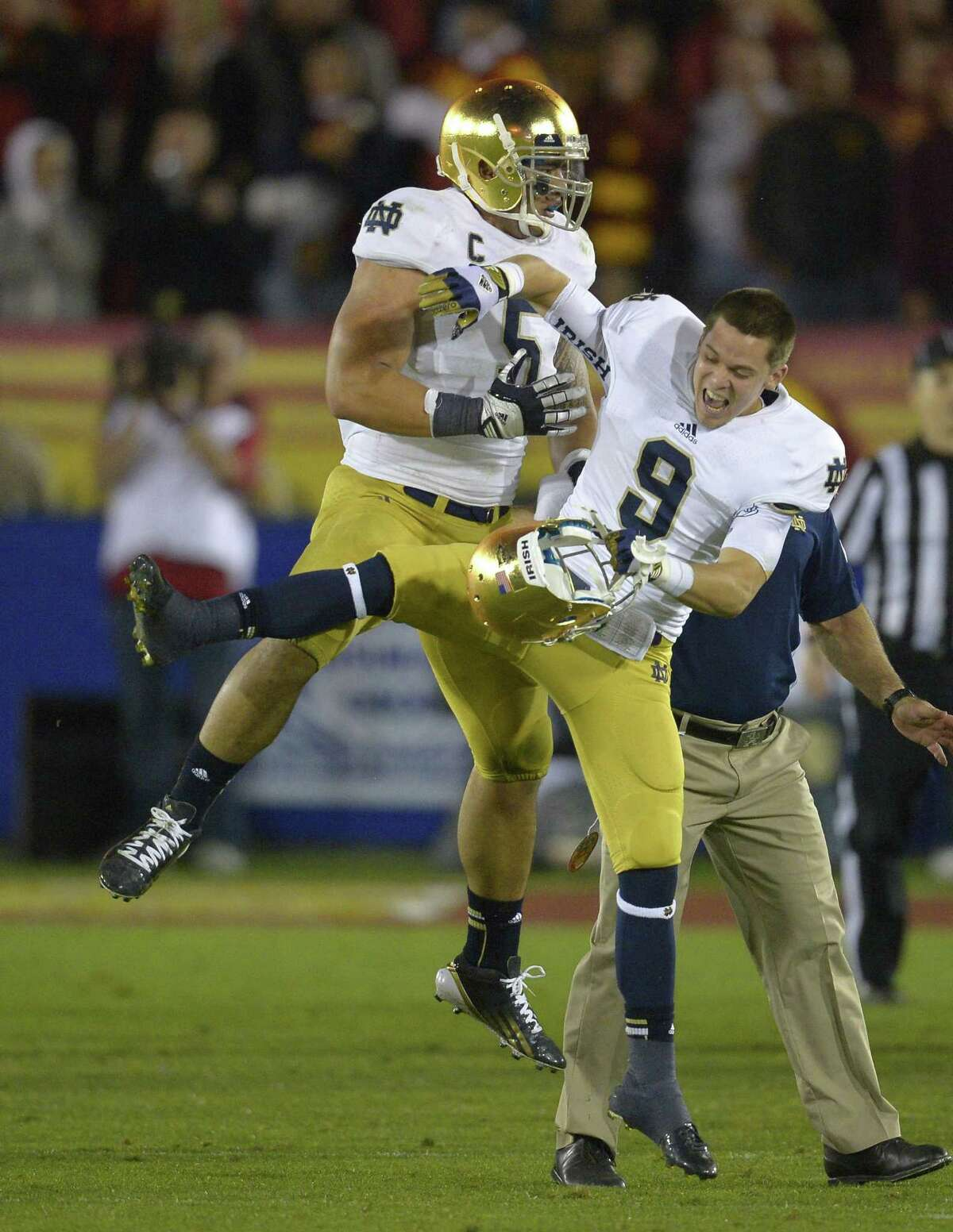 Notre Dame linebacker Manti Te'o, left, celebrates with Notre Dame wide receiver Robby Toma in the closing seconds of their game against USC. By The Associated Press