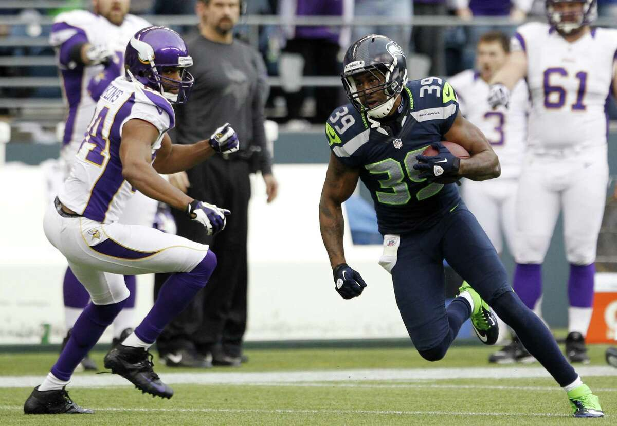 Seattle Seahawks' Brandon Browner takes off past Minnesota Vikings' Michael Jenkins after an interception late in the second half of the Seahawks November 4th contest.
