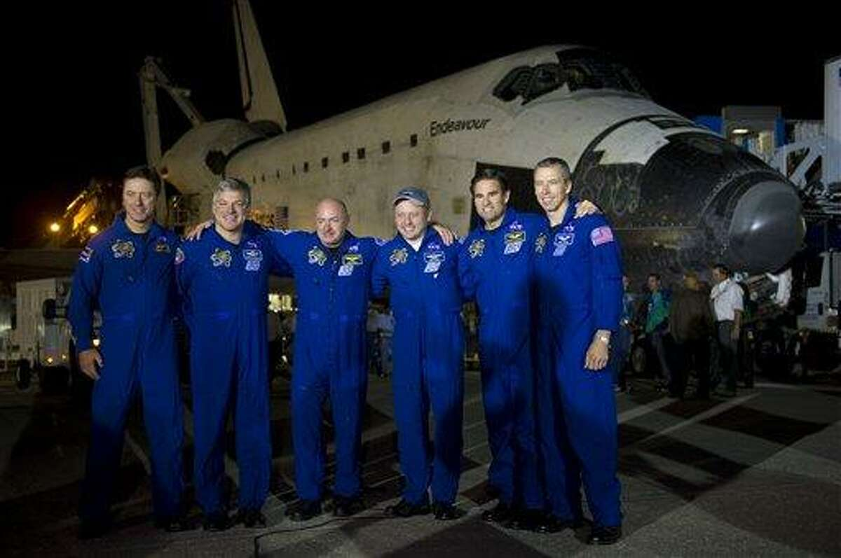 The STS-134 astronauts from left, European Space Agency's Roberto Vittori, Gregory H. Johnson, pilot; Mark Kelly, commander; and Michael Fincke, Greg Chamitoff, and Andrew Feustel, all mission specialists, pose for a group photograph shortly after landing onboard the space shuttle Endeavour at the Shuttle Landing Facility (SLF) at Kennedy Space Center, Wednesday, June 1, 2011, in Cape Canaveral, Fla. Endeavour, completed a 16-day final mission to outfit the International Space Station. Endeavour spent 299 days in space and traveled more than 122.8 million miles during its 25 flights. It launched on its first mission on May 7, 1992. (AP Photo/NASA, Bill Ingalls) MANDATORY CREDIT