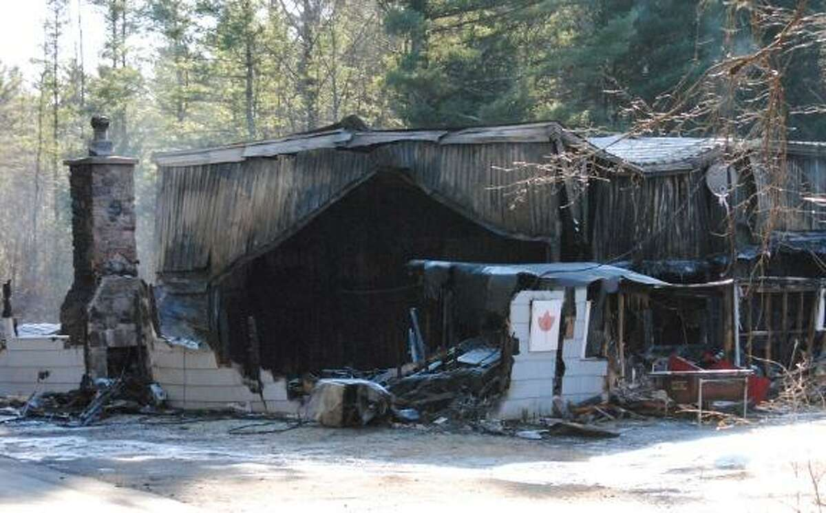File photo The Norfolk Curling Club building, in a photo taken the day after the fire on Dec. 18, 2011. Members plan to demolish the remains of the structure on Saturday, Feb. 4.
