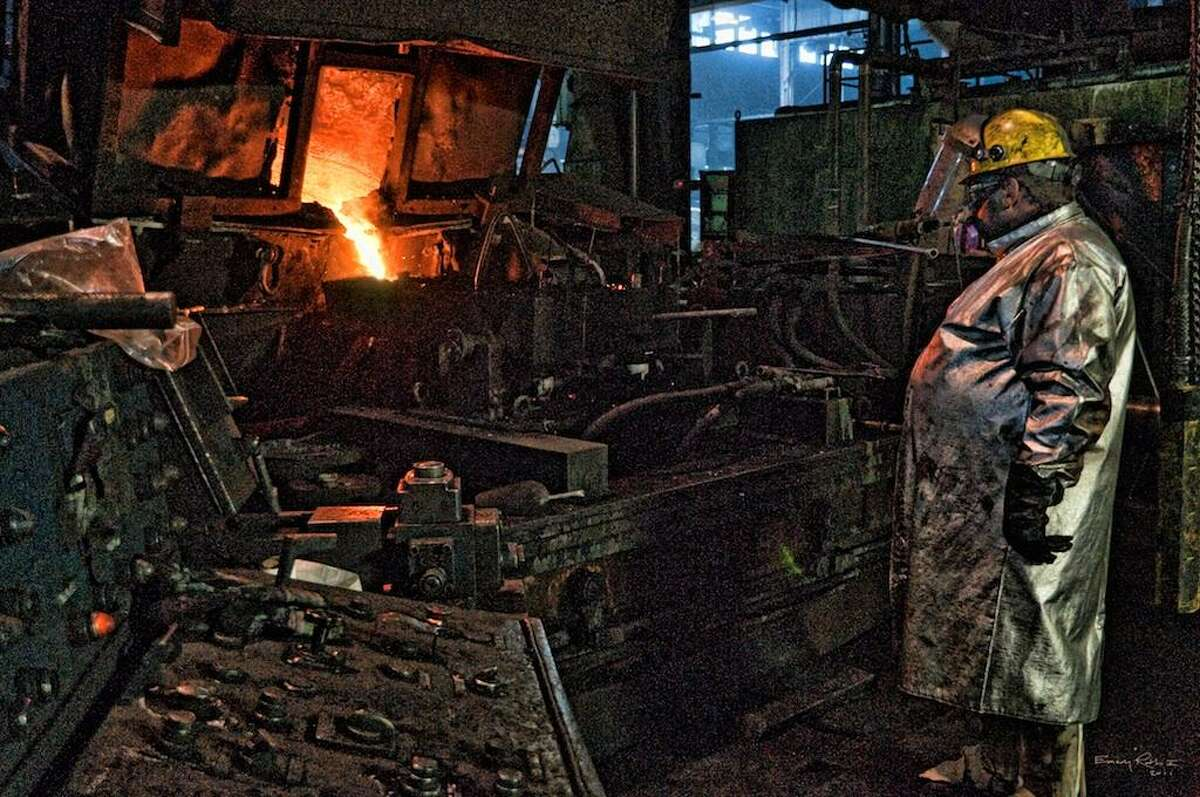 Photograph by Emery Roth II A photograph taken by Emery Roth II of a factory in Waterbury is among the collection of images on display at the Register Citizen Newsroom Cafe this month.