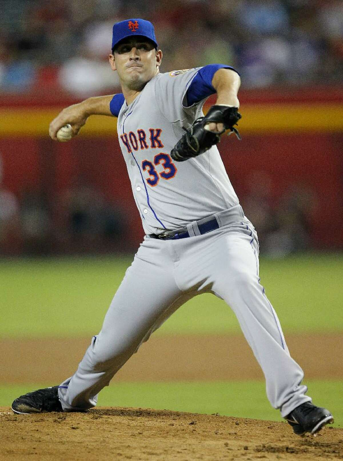 ASSOCIATED PRESS New York Mets pitcher Matt Harvey delivers a pitch in his major league debut against the Arizona Diamondbacks on Thursday in Phoenix. The Mets won 3-1. Harvey struck out 11 and picked up the win in his debut.
