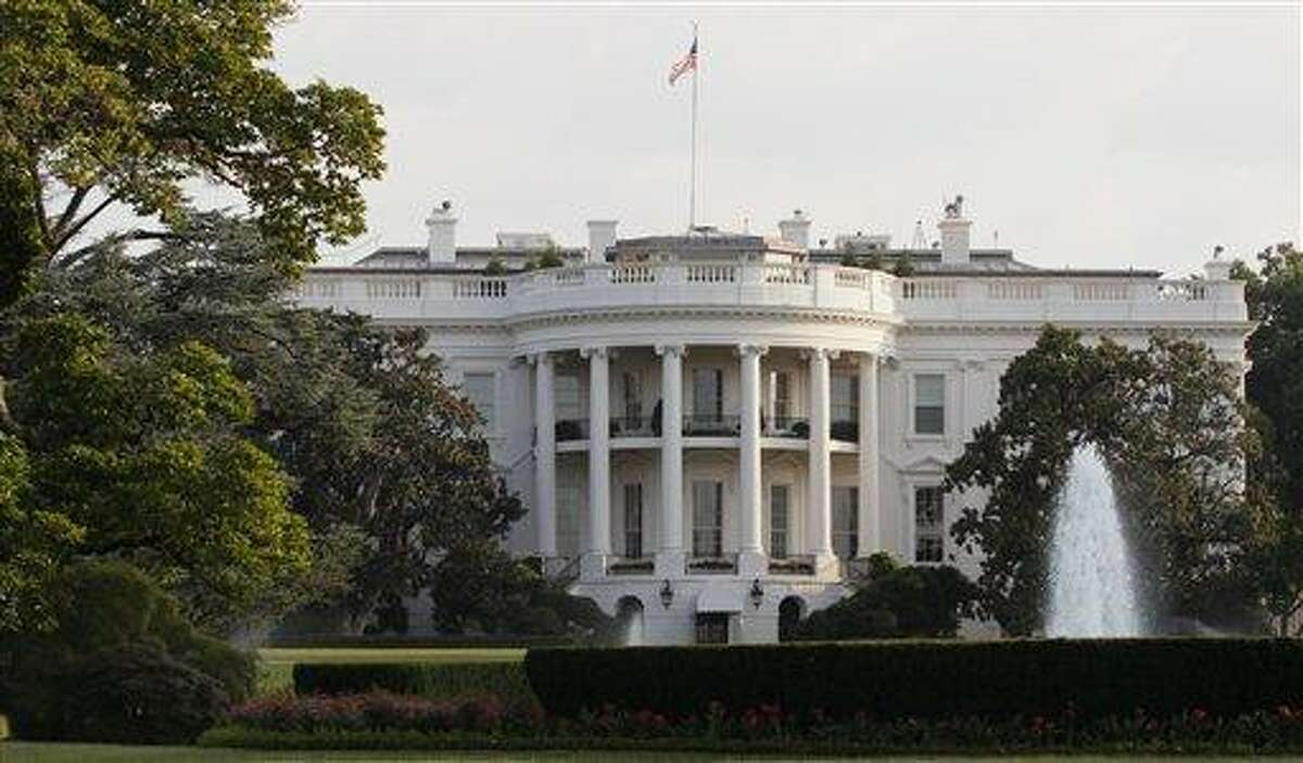 The White House is seen early Sunday as the debt crisis continued. President Obama announced Sunday night that a deal had been agreed upon to avert a possible federal default. (AP Photo/Carolyn Kaster)
