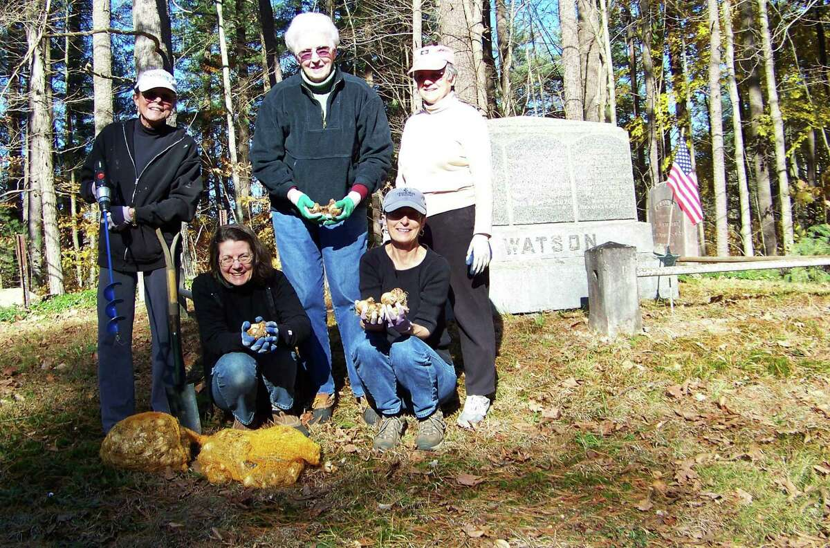 Submitted photo Members of the New Hartford Garden Club recently volunteered their time at the Old Nepaug Cemetery, after joining member Linda Dryansky in an effort to brighted the little cemetery.