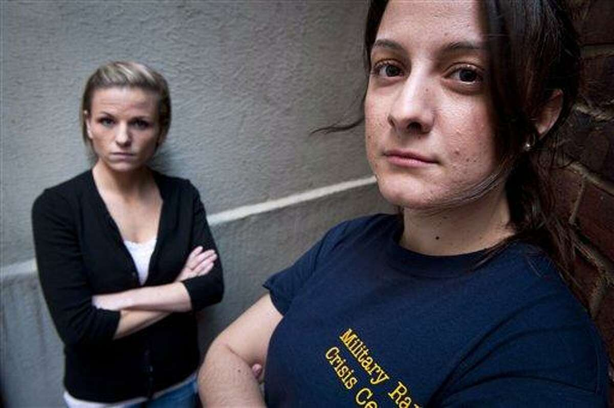 Veterans Kori Cioca, 25, of Wilmington, Ohio, left, and Panayiota Bertzikis, 29, of Somerville, Mass., both assaulted and raped while serving in the U.S. Coast Guard, meet at their attorney's office in Washington, Sunday, Feb. 13, 2011. They are plaintiffs among about a dozen women and at least one man, who are suing Pentagon officials, seeking change in the military's handling of rape, and sexual assault cases. (AP Photo/Cliff Owen)