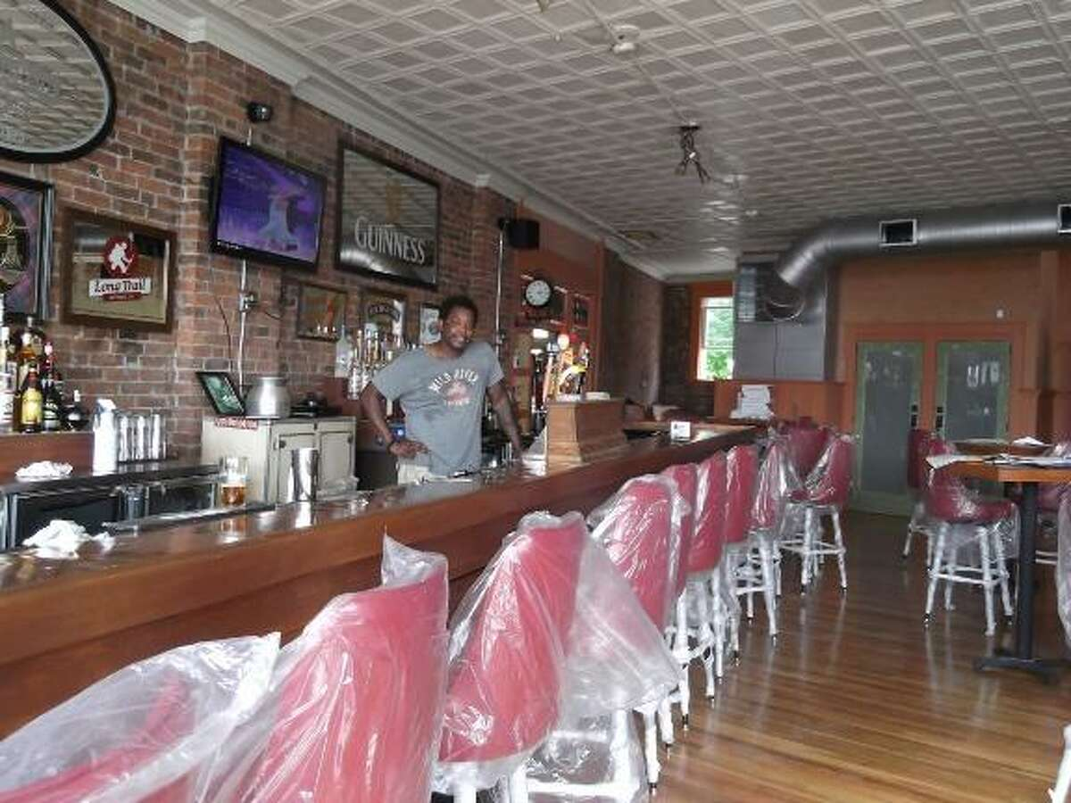 Julian Sawyer, the owner of Sawyer's Bar and Grill in Torrington, just installed taps in the bar. He's hoping to open the new bar on the corner of Franklin Street and Center Street the first week of August. (MICHELLE MERLIN/Register Citizen)