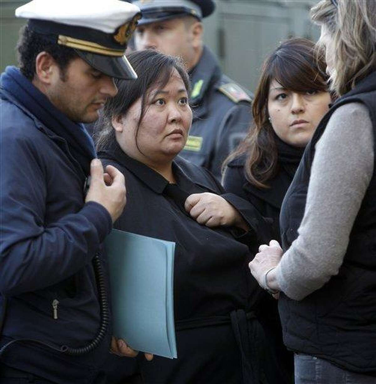 Sara Kim Heil, second left, daughter of Barbara and Gerald Heil, of White Bear Lake, Minn., both missing in the cruise ship Costa Concordia accident, talks to Italian authorities in the port of Tuscan island of Giglio, Italy, Jan. 22. Associated Press