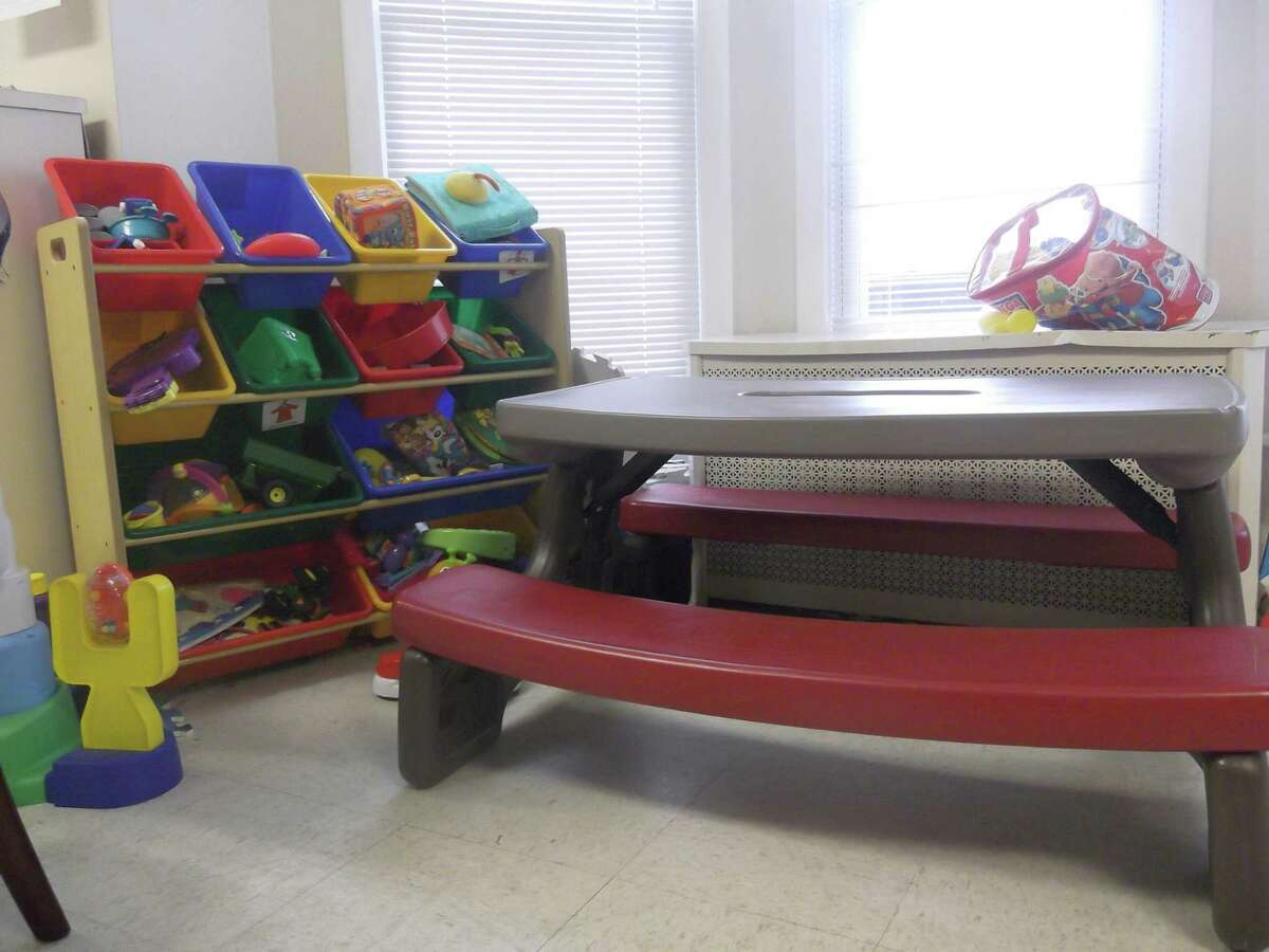 RICKY CAMPBELL/ Register Citizen A lone children's play table sits in the den of Torrington's FISH, Inc. homeless shelter, ready for young visitors. The local agency is doing its best to keep up with a national trend of increasing numbers of homeless families seeking refuge.