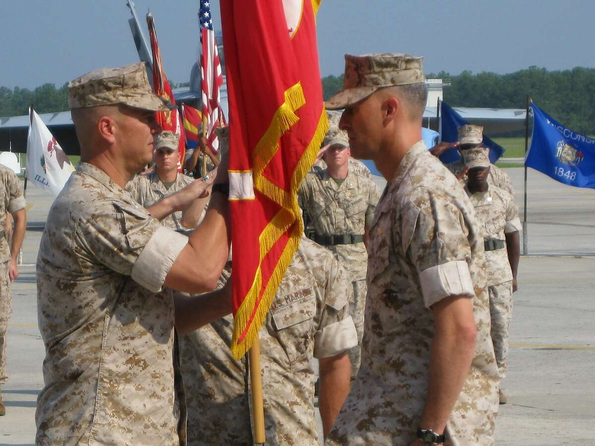 Photo by Pfc. Rubin J. Tan Colonel Michael Cederholm, the Marine Aircraft Group 31 commanding officer, and Col. David Robinson, the outgoing MAG-31 commanding officer, receives the Marine Corps colors.