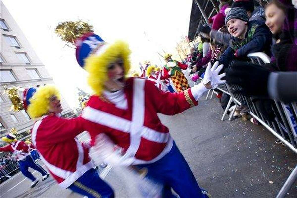 Clowns march in the Macy's Thanksgiving Day Parade in New York, Thursday, Nov. 22, 2012. (AP Photo/Charles Sykes)