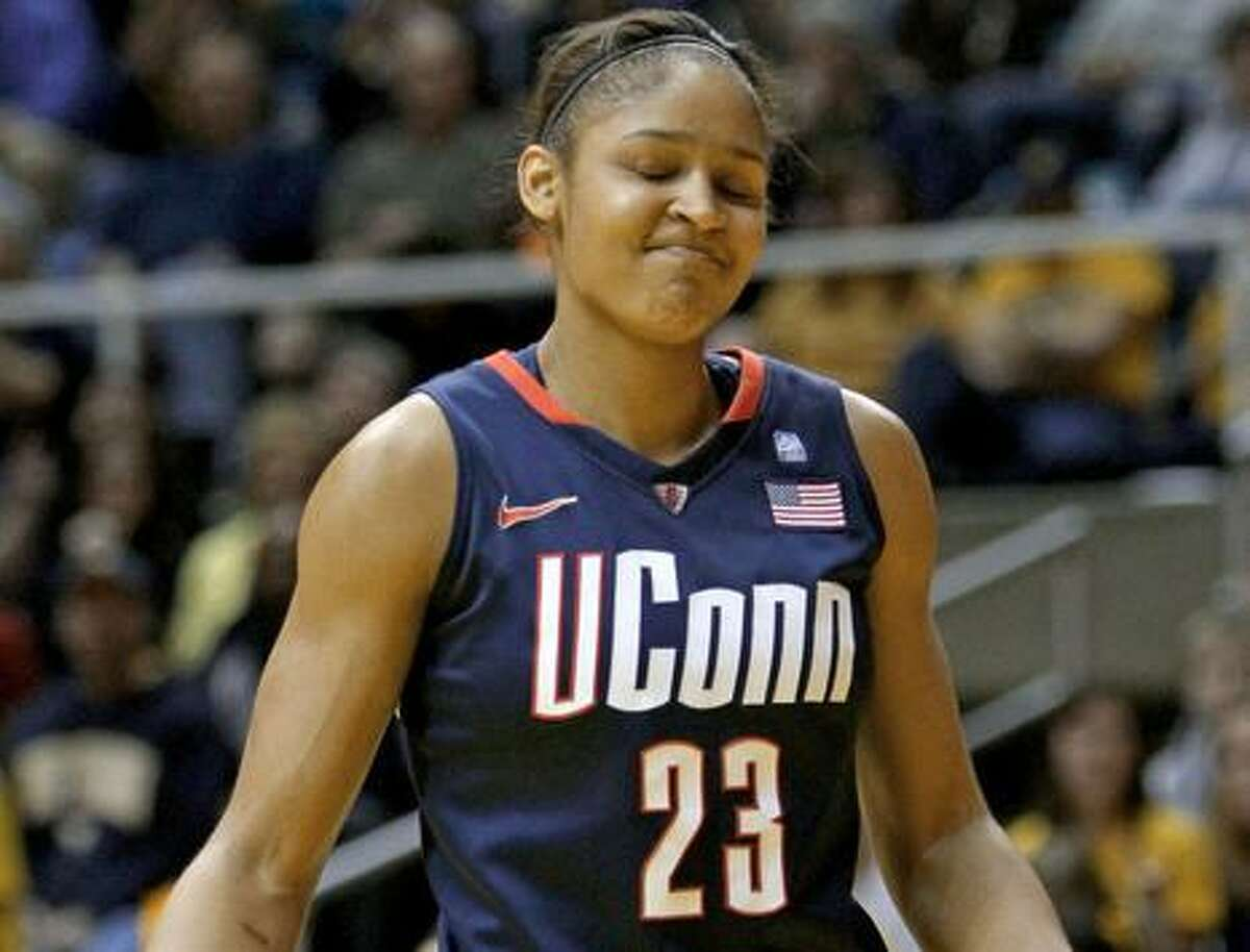 Connecticut's Maya Moore reacts to a turnover in the first half of an NCAA college basketball game in Morgantown, W.Va. on Tuesday, Feb. 8, 2011. (AP Photo/David Smith)