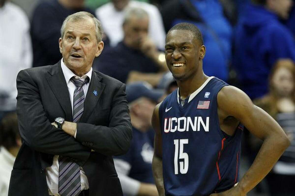 Connecticut head coach Jim Calhoun, left, stands with player Kemba Walker (15) near the end of the second half of an NCAA college basketball game against Seton Hall, Saturday, Feb. 5, 2011 in Newark, N.J. Connecticut won 61-59. (AP Photo/Mel Evans)