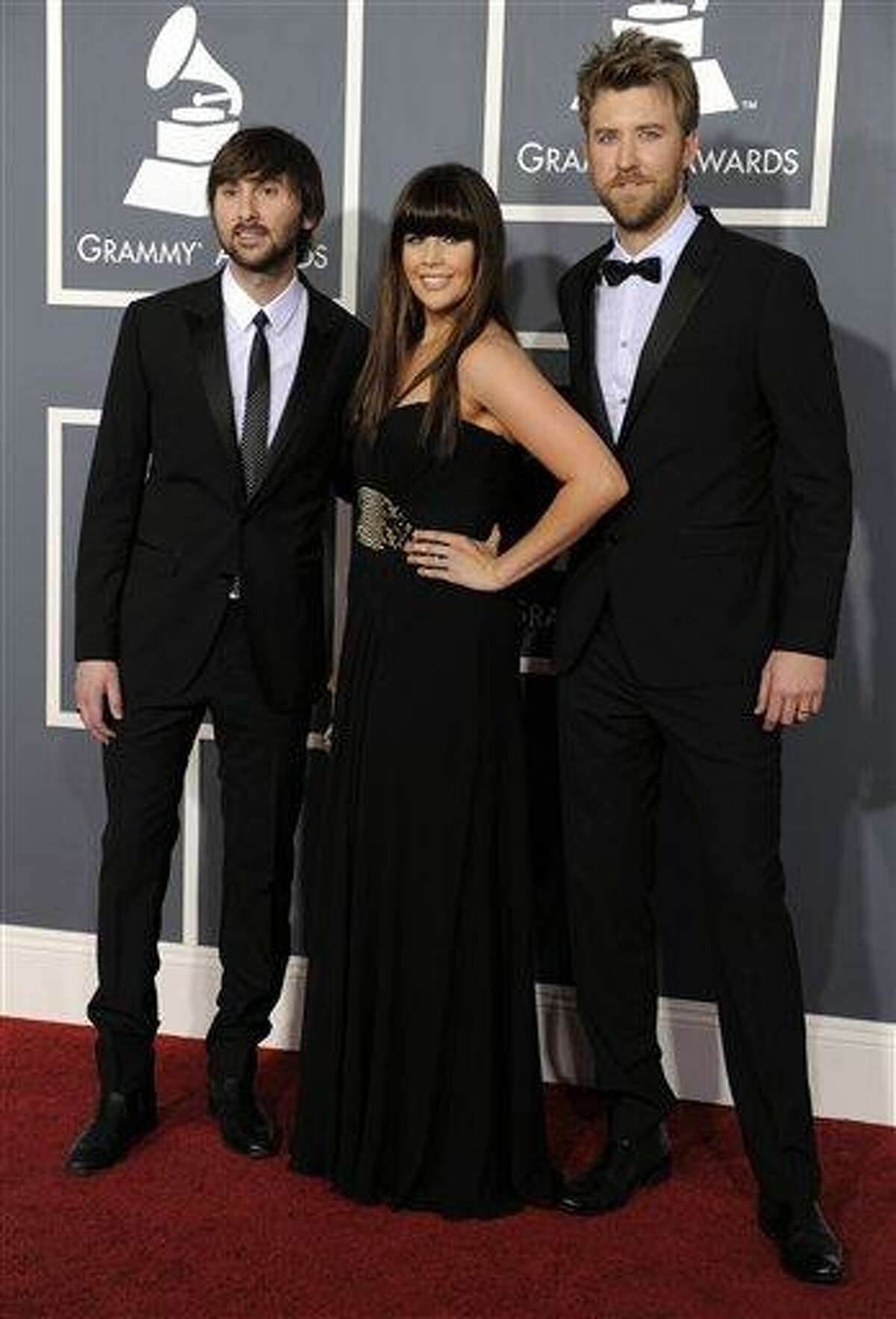 Lady Antebellum, from left, Dave Haywood, Hilary Scott, and Charles Kelley arrive at the 53rd annual Grammy Awards on Sunday, Feb. 13, 2011, in Los Angeles. (AP Photo/Chris Pizzello)