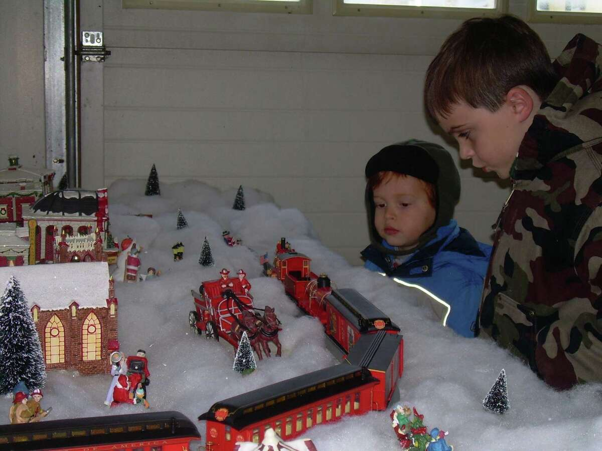 Submitted photo Children enjoy a train display at last year's Christmas in Riverton event. The annual celebration takes place Dec. 2-3 this year.