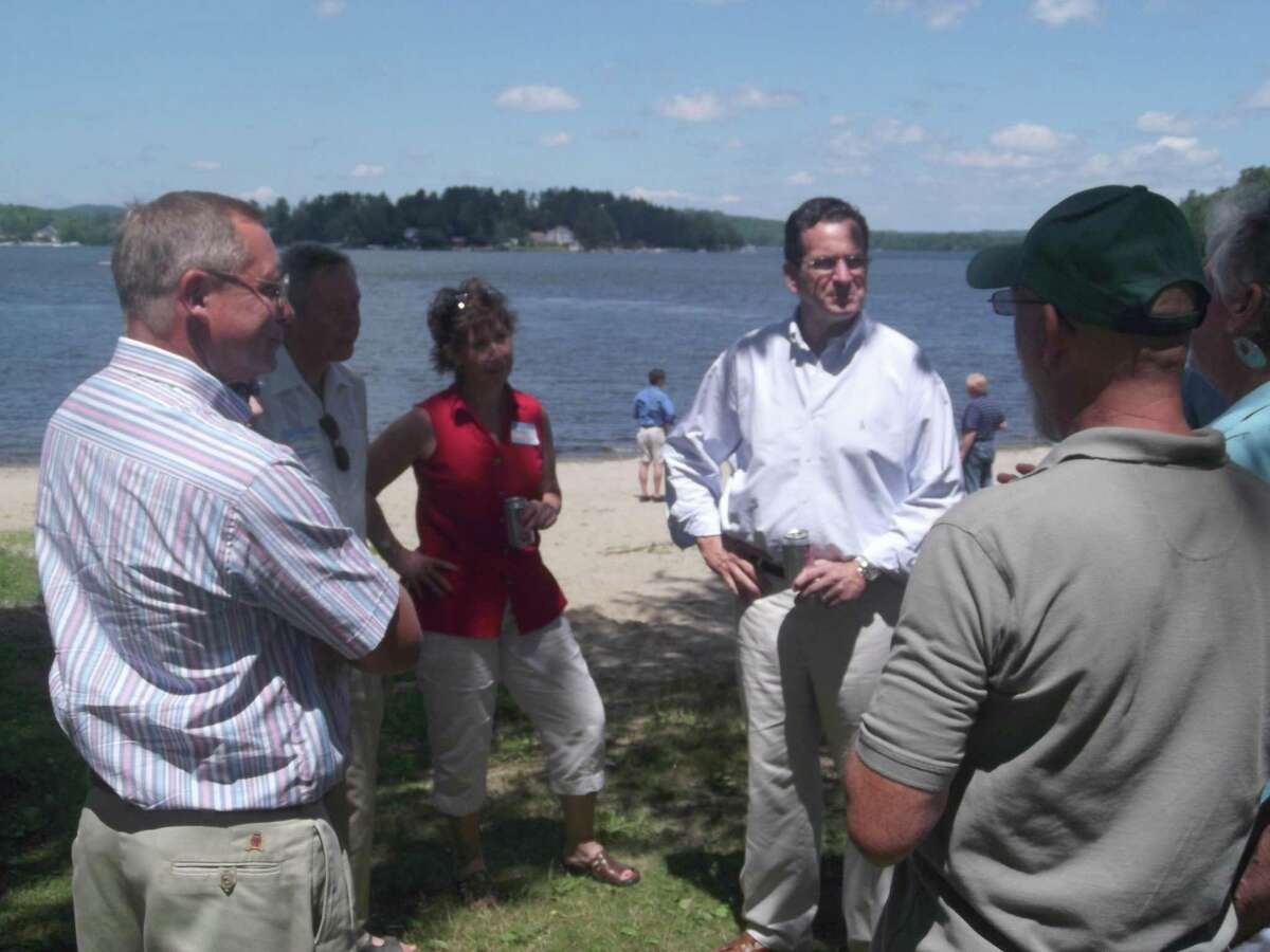 RICKY CAMPBELL/ Register Citizen Gov. Dannel P. Malloy meets with area Democrats Saturday at the Morris Town Beach on Bantam Lake. Malloy was joined by many state and local officials during the 4th Annual Bantam Lake Outing to raise awareness for the environment and discuss issues facing the lake.