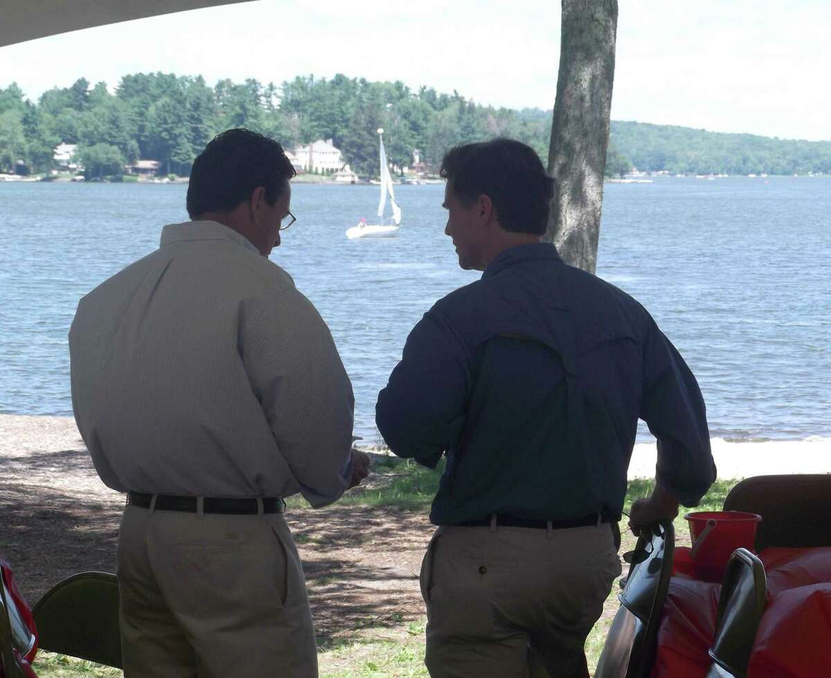 RICKY CAMPBELL/ Register Citizen While overlooking Bantam Lake and eating some barbecued lunch, Gov. Dannel P. Malloy talks with Department of Energy and Environmental Protection Commissioner Daniel C. Esty. The duo visited the Morris Town Beach Saturday for the 4th Annual Bantam Lake Outing, sponsored by the Northwest Connecticut Democratic Town Committees.