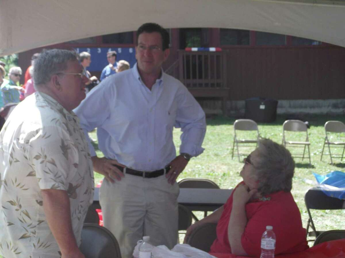RICKY CAMPBELL/ Register Citizen Litchfield residents Joe and Beverly Manes meet with Gov. Dannel P. Malloy Saturday during the Bantam Lake Outing on the Morris Town Beach.