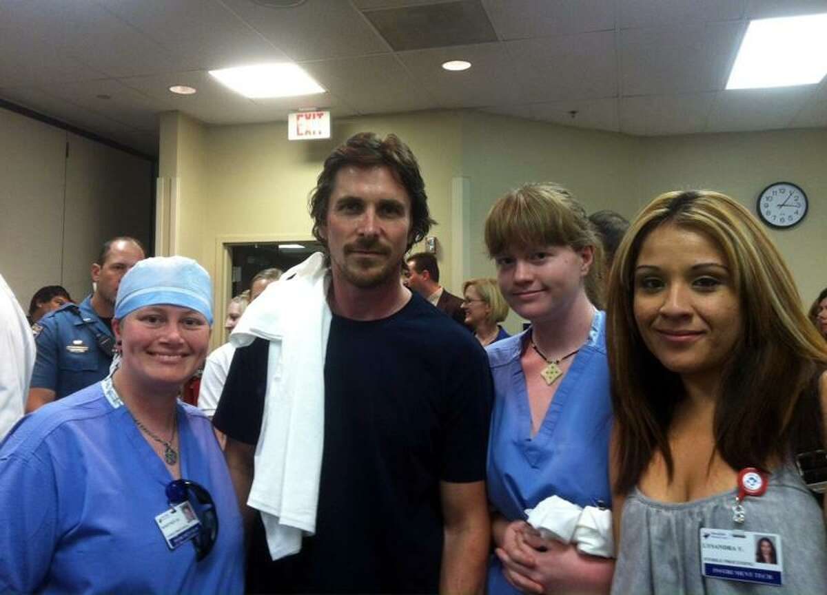 In this photo provided by Swedish Medical Center, actor Christian Bale, second left, poses Tuesday with Swedish Medical Center staff at The Medical Center of Aurora, Colo. Associated Press