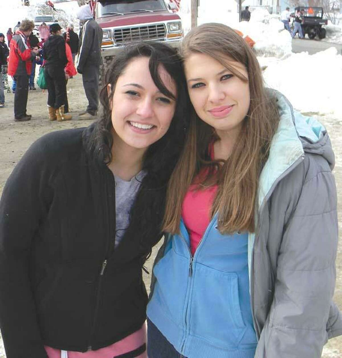 MIKE AGOGLIATI/ Register CitizenLitchfield High School senior Fidan Shamkhalova, left, participated in the Penguin Plunge for the fourth year in a row. Shamkhalova posed with a friend after the plunge.