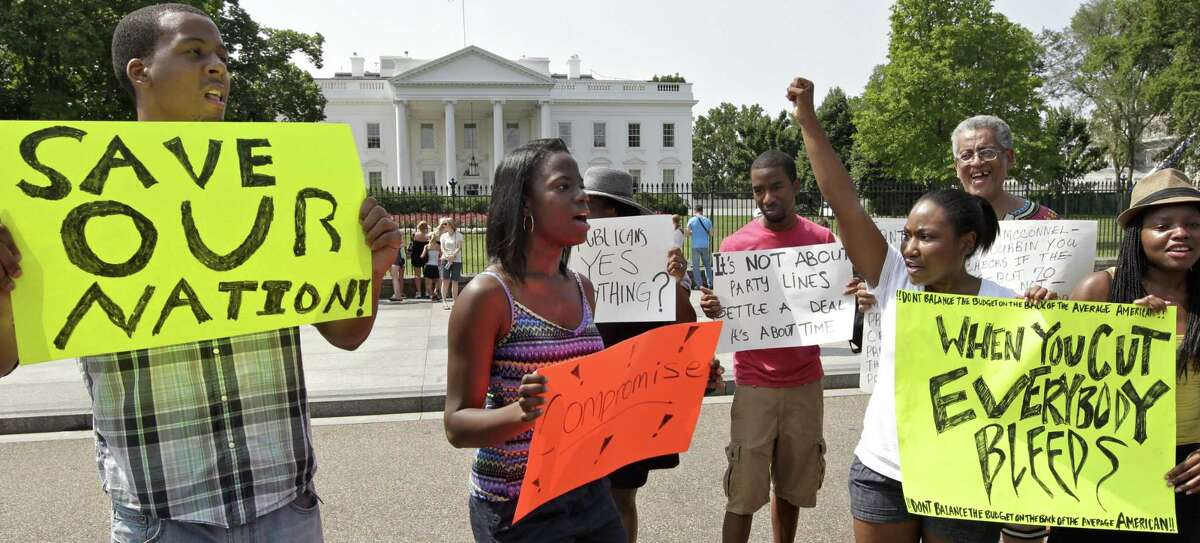 A small group of college students who are Facebook friends make an appeal to President Obama and Congressional leaders meeting inside the White House to reach a compromise on the debt limit, in Washington, Saturday, July 23, 2011. (AP Photo/J. Scott Applewhite)