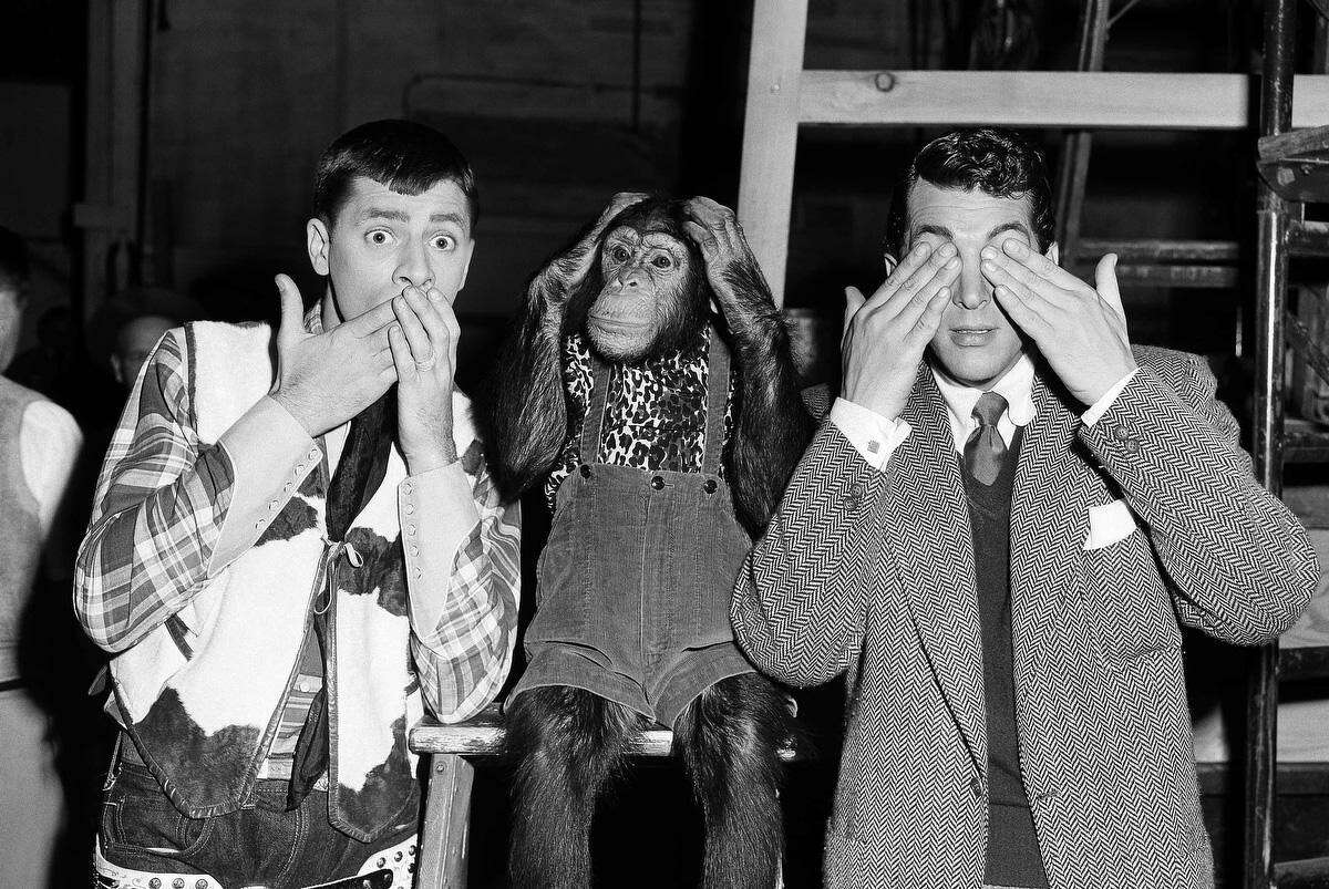 Some Hollywood press agent must have wracked his brains to come up with this version of an old Chinese proverb for a publicity stunt. The actors from left to right are Jerry Lewis, Pierre, and Dean Martin shown July 13, 1950. (AP Photo/Paramount)