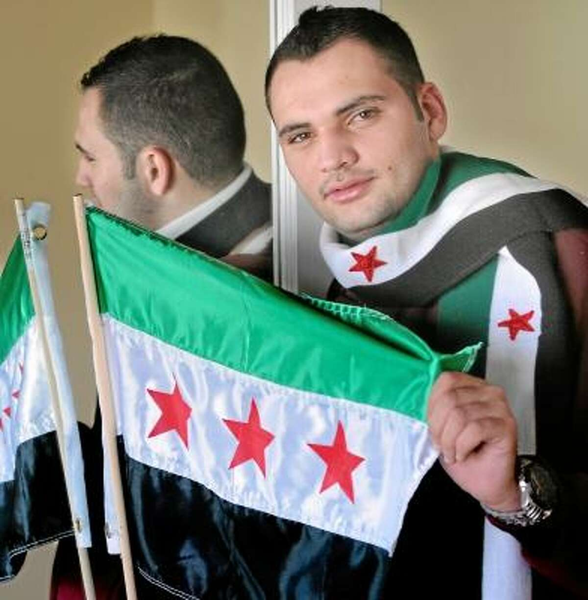 CCSU student and Syrian Abdul Kreiyeh at his Middletown home. Kreiyah and his family left Syria several months ago after harrowing experiences. Mara Lavitt/New Haven Register 11/24/12
