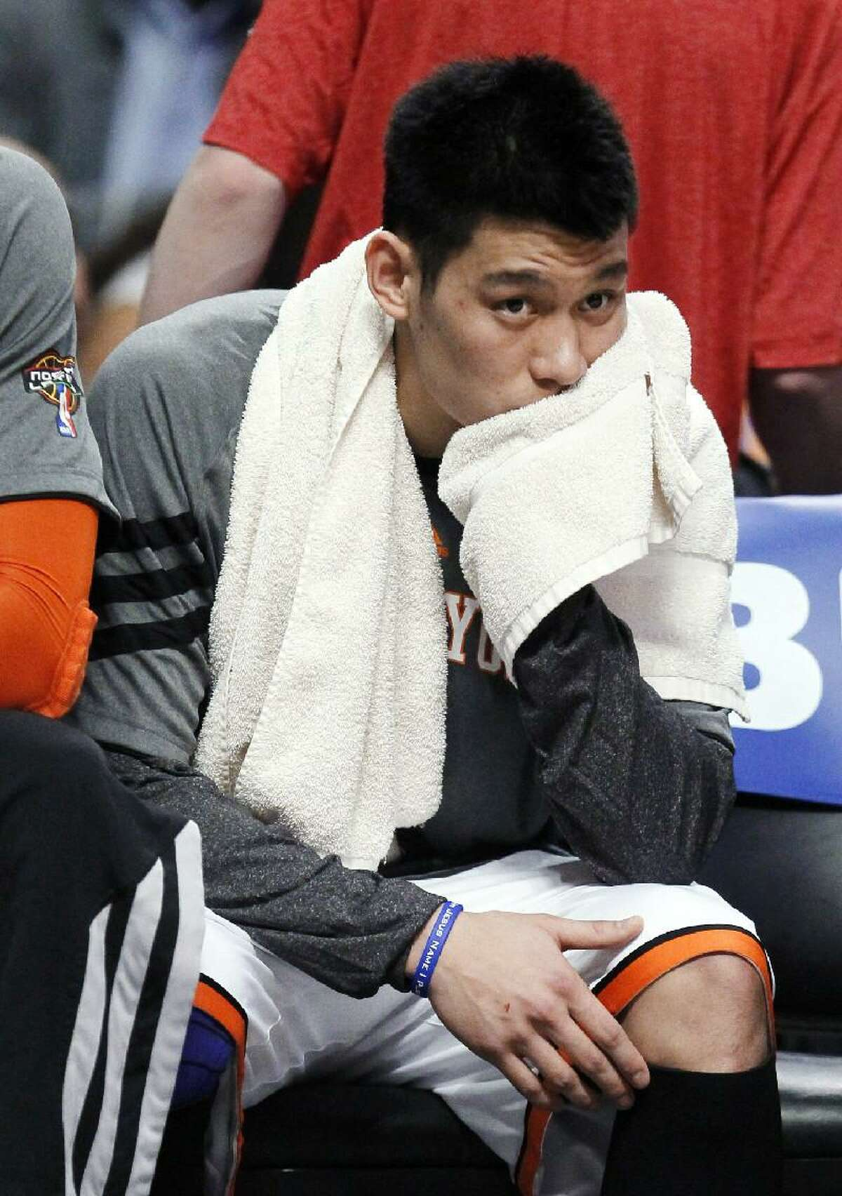ASSOCIATED PRESS In this March 12 file photo, New York Knicks guard Jeremy Lin sits on the bench during the first half of a game against the Chicago Bulls in Chicago. Lin is having left knee surgery and will miss six weeks, likely ending his amazing breakthrough season. The team said Saturday that the point guard had an MRI exam this week that revealed a small, chronic meniscus tear.