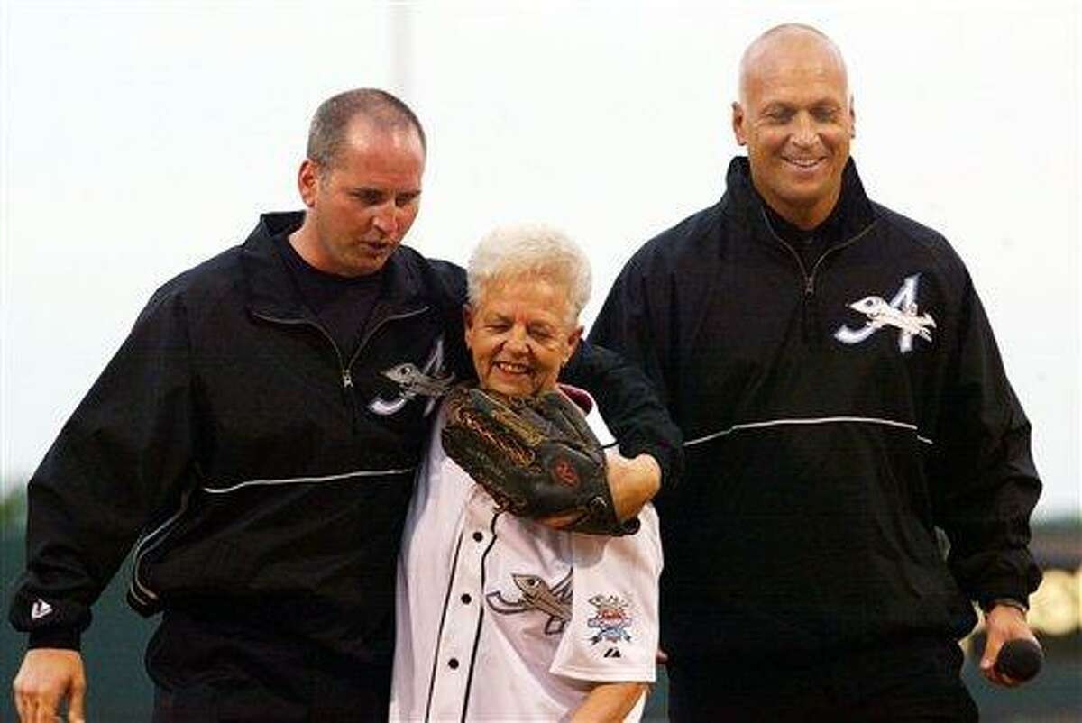 This 2002 file photo shows Cal Ripken Jr., right, owner of the Aberdeen IronBirds, and his brother, Bill, walking off the field with their mother, Vi, after she threw out the ceremomial first pitch prior to the team's season-opening debut at the new Ripken Stadium in Aberdeen, Md. Police say Cal Ripken Jr.'s mother is safe after an armed man abducted her from her home northeast of Baltimore. Associated Press