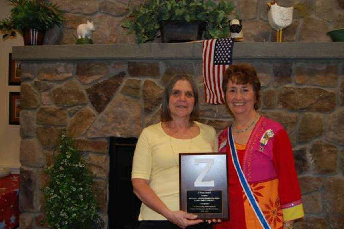 Submitted photo Above left, Karen Brett of Barkhamsted, Regent of the Brooks-Green Woods Chapter, National Society Daughters of the American Revolution, and Joyce Cahill of Simsbury, State Regent, Connecticut DAR, with the 2010-2011. CTDAR -Team Award for Outstanding Achievement in Chapter Development and Revitilization which was presented to the Chapter at the 118th CTDAR State Conference in April.