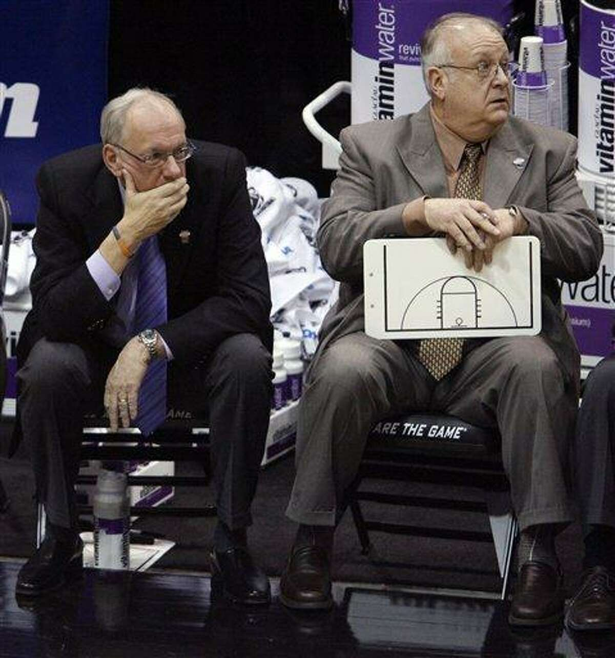 FILE - In this March 25, 2010, file photo, Syracuse coach Jim Boeheim, left, and assistant coach Bernie Fine sit on the bench at the end an NCAA West Regional semifinal college basketball game against Butler in Salt Lake City. Syracuse has placed longtime assistant basketball coach Fine on administrative leave