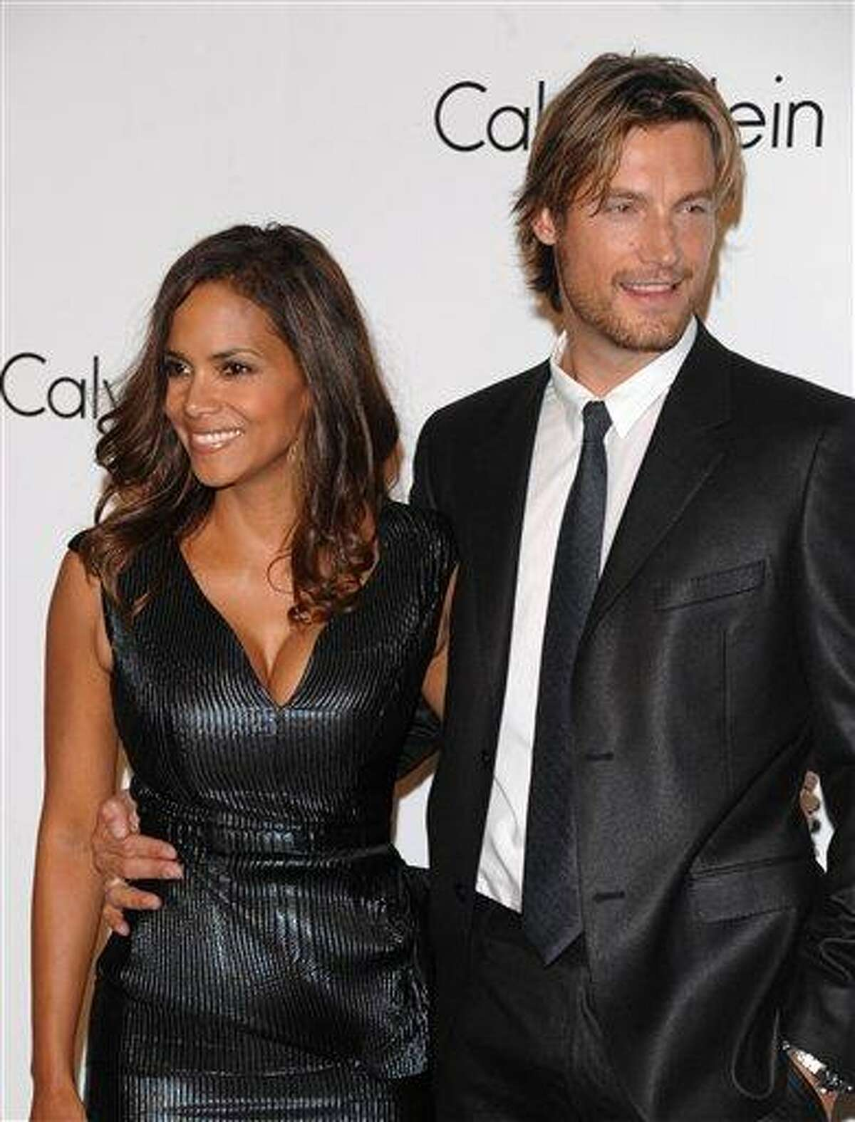 Model Gabriel Aubry and actress Halle Berry attend the Calvin Klein 40th anniversary party during Fashion Week in New York in 2008. Berry's ex-boyfriend Aubry was arrested for investigation of battery after he and the Oscar-winning actress' current boyfriend got into a fight at her California home, police said Thursday. Associated Press file photo