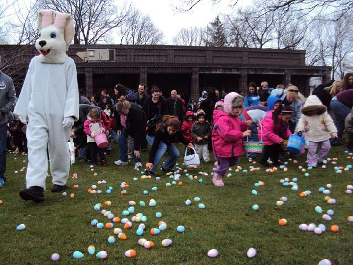 RICKY CAMPBELL/ Register Citizen Kids rush after Easter eggs strewn across the grass at Coe Memorial Park Saturday, hoping to gather as many as possible. The annual Easter egg hunt, sponsored by the Torrington Parks and Recreation Department, drew hundreds of children and their families to the downtown location.