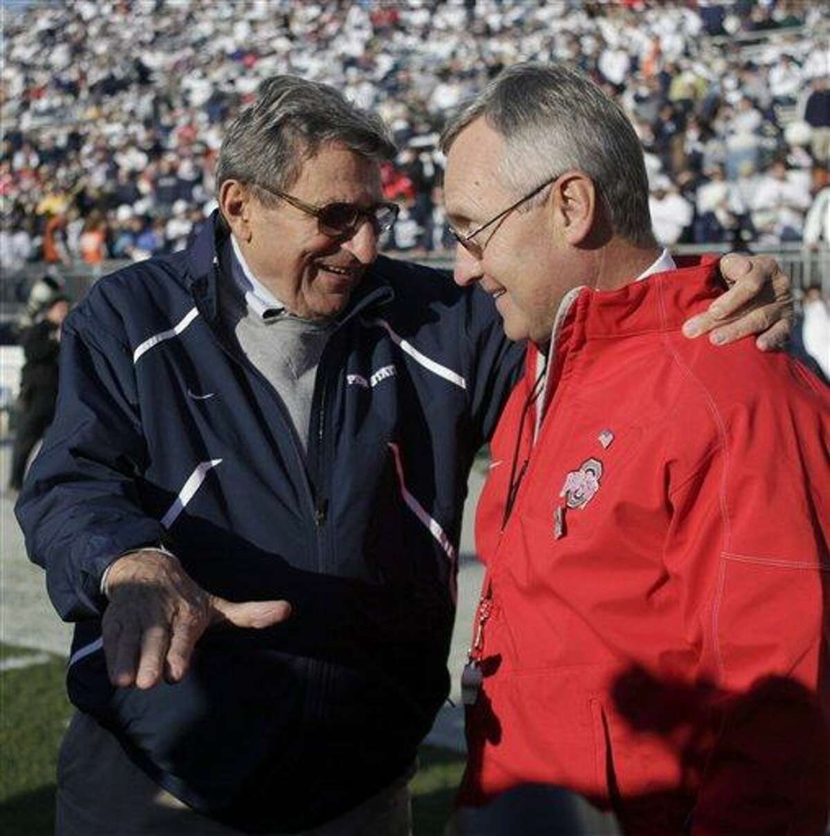 FILE - In this Nov. 7, 2009 file photo, Penn State head coach Joe Paterno, left, chats with Ohio State head coach Jim Tressel, right, before the start of their NCAA college football game in State College, Pa. A year ago, Penn State at Ohio State would have been a matchup of two of college football powers led by coaches with images beyond reproach. (AP Photo/Carolyn Kaster, File)