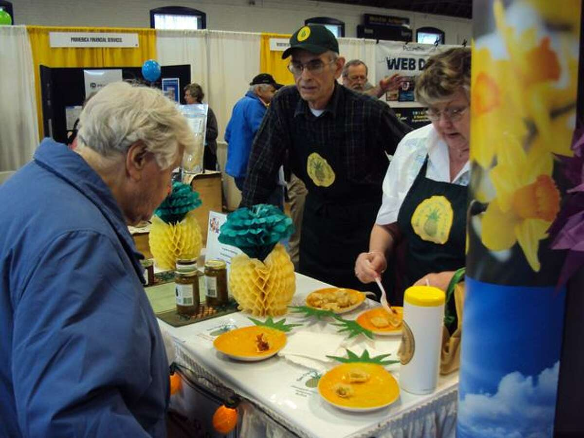 RICKY CAMPBELL/Register Citizen Guests sample tasty treats at the Northwest Connecticut's Chamber of Commerce Home and Business Expo at the Torrington Armory Saturday. The event continues Sunday.