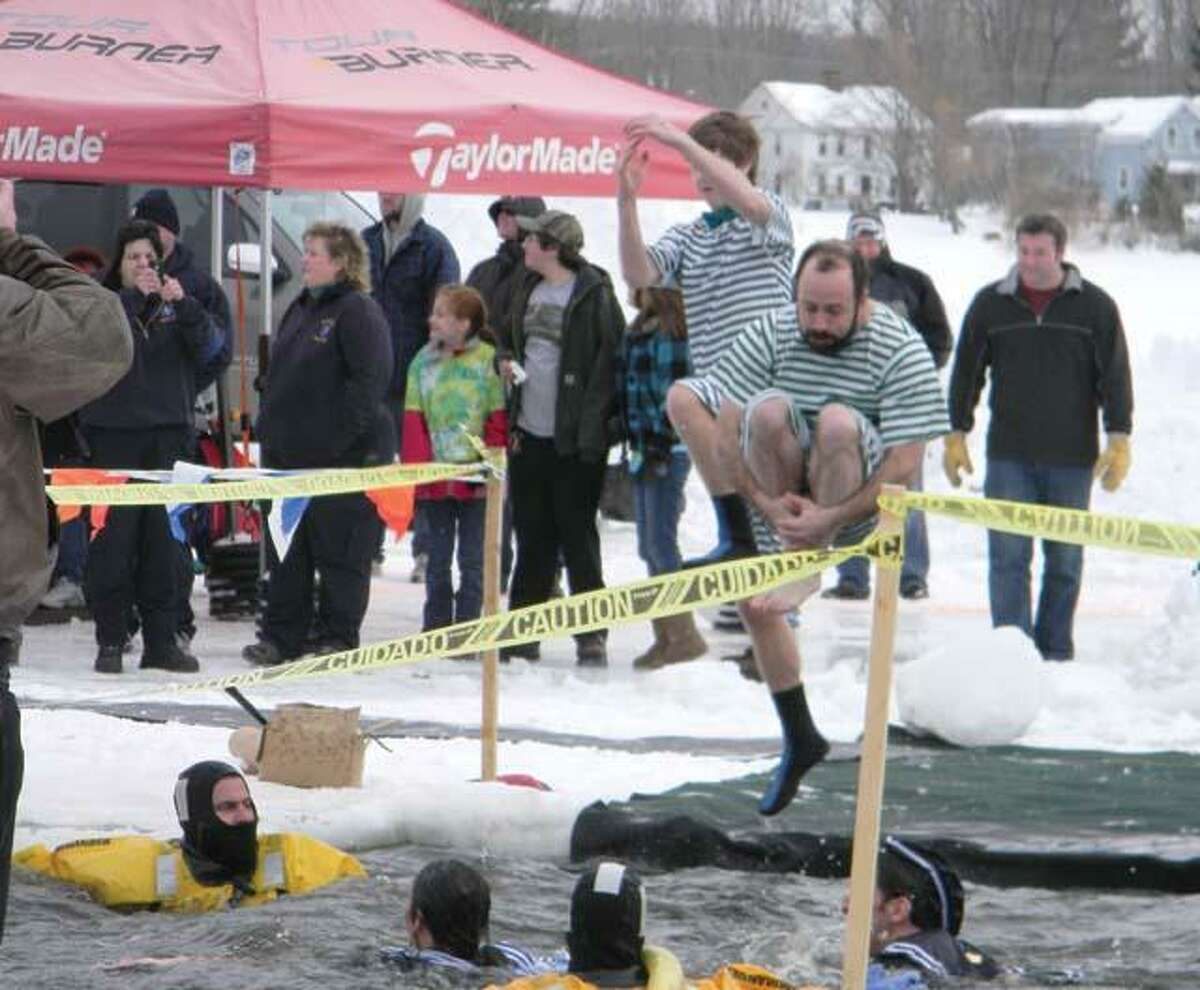 MIKE AGOGLIATI/ Register CitizenMore than 75 people participated in the Penguin Plunge in Winsted on Saturday.