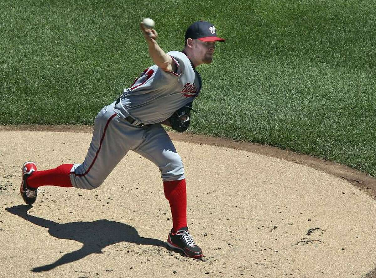 ASSOCIATED PRESS Washington Nationals starting pitcher Stephen Strasburg throws during the first inning of Wednesday's game against the New York Mets at Citi Field in New York. The Nationals won 5-2.