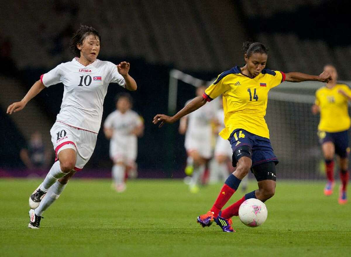 ASSOCIATED PRESS North Korea's Yun Hyon Hi, left, looks to tackle Colombia's Kelis Peduzine during the women's group G match between Colombia and North Korea at the London 2012 Summer Olympics Wednesday at Hampden Park Stadium in Glasgow.