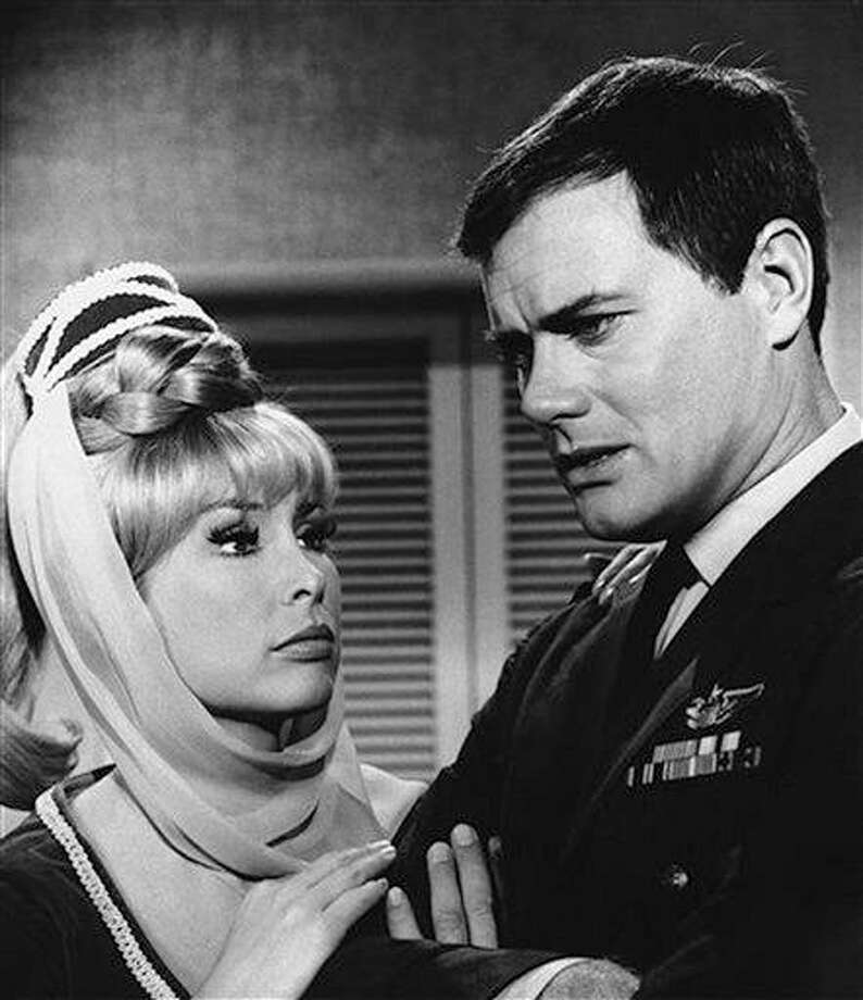 "FILE - This 1967 file photo shows Barbara Eden, left, and Larry Hagman in a scene from the television show ""I Dream of Jeannie.""  Actor Larry Hagman, who for more than a decade played villainous patriarch JR Ewing in the TV soap Dallas, has died at the age of 81, his family said Saturday Nov. 24, 2012.  (AP Photo/NBC, file) Photo: AP / NBC"