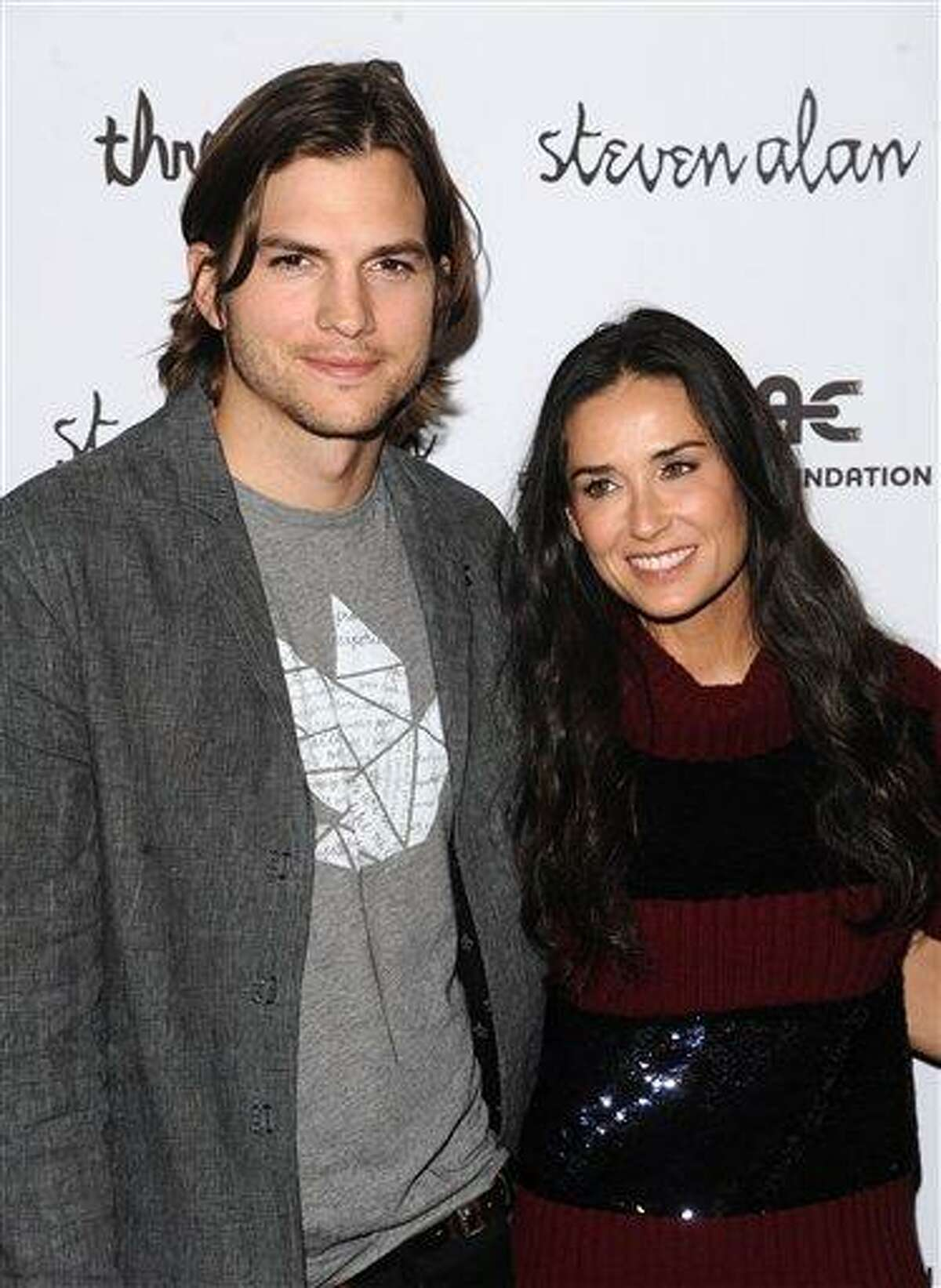 FILE - In this April 14, 2011 file photo, Ashton Kutcher and Demi Moore attend the