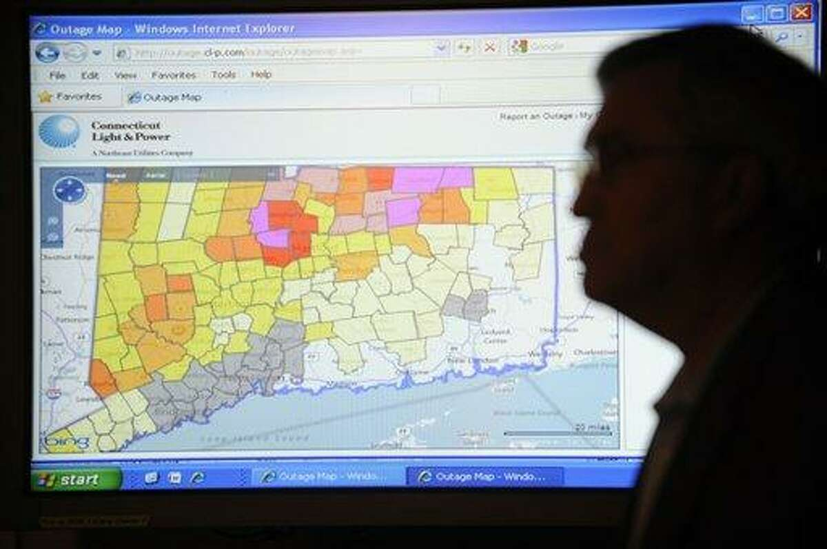 President and Chief Operating Officer of Connecticut Light & Power, Jeffrey D. Butler, stands in front of an outage map as he waits to speak to the media during a news conference at the Emergency Operations Center at the Hartford Armory in Hartford, Conn., Sunday, Nov. 6, 2011. CL&P announced this morning that it would not meet its self-identified goal of 99% power restoration in each city and town by midnight tonight. (AP Photo/Jessica Hill)