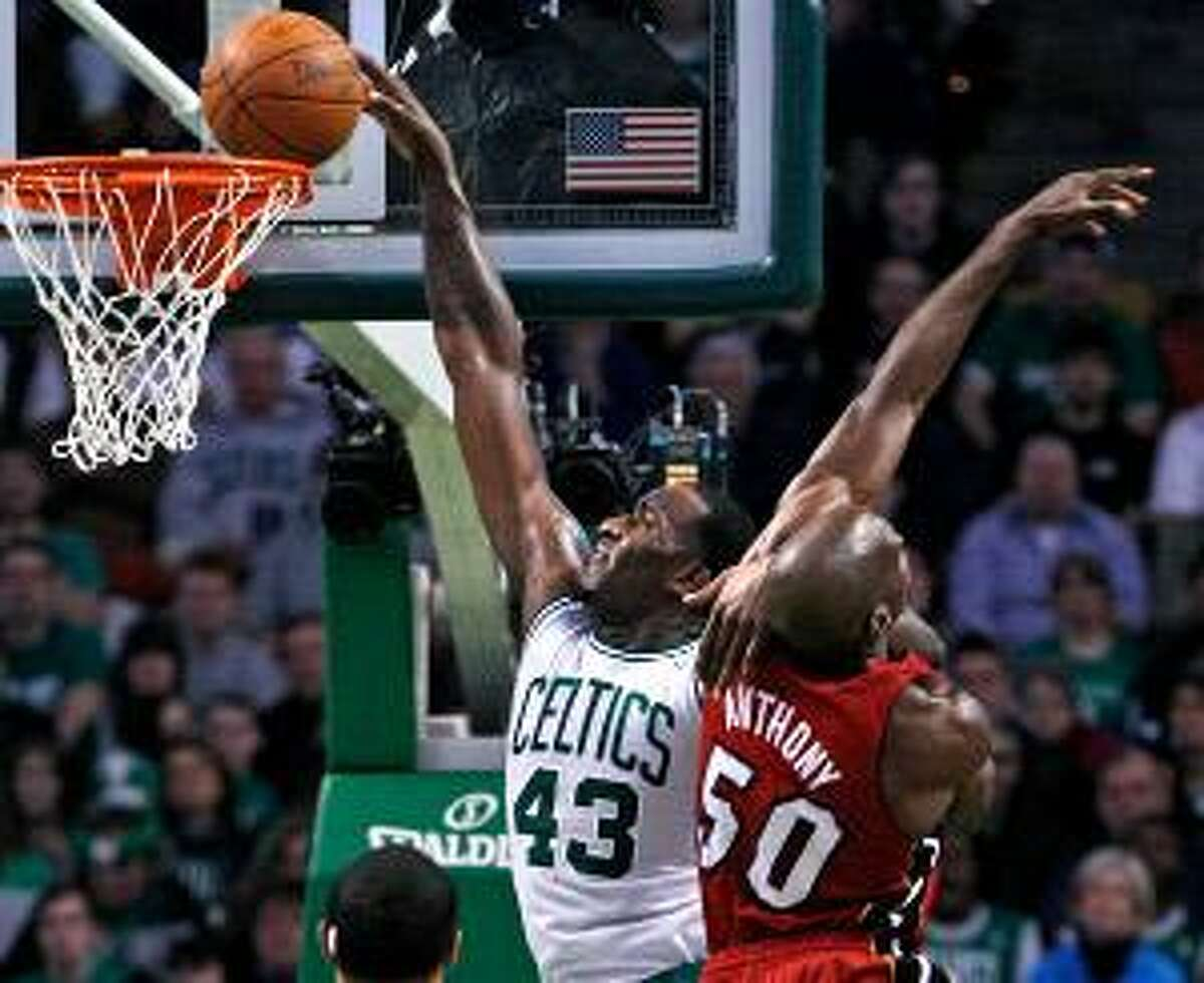 Boston Celtics center Kendrick Perkins (43) scores over Miami Heat center Joel Anthony (50) during the first half of Sunday's game Boston. The Celtics won 85-82. (AP Photo/Elise Amendola)