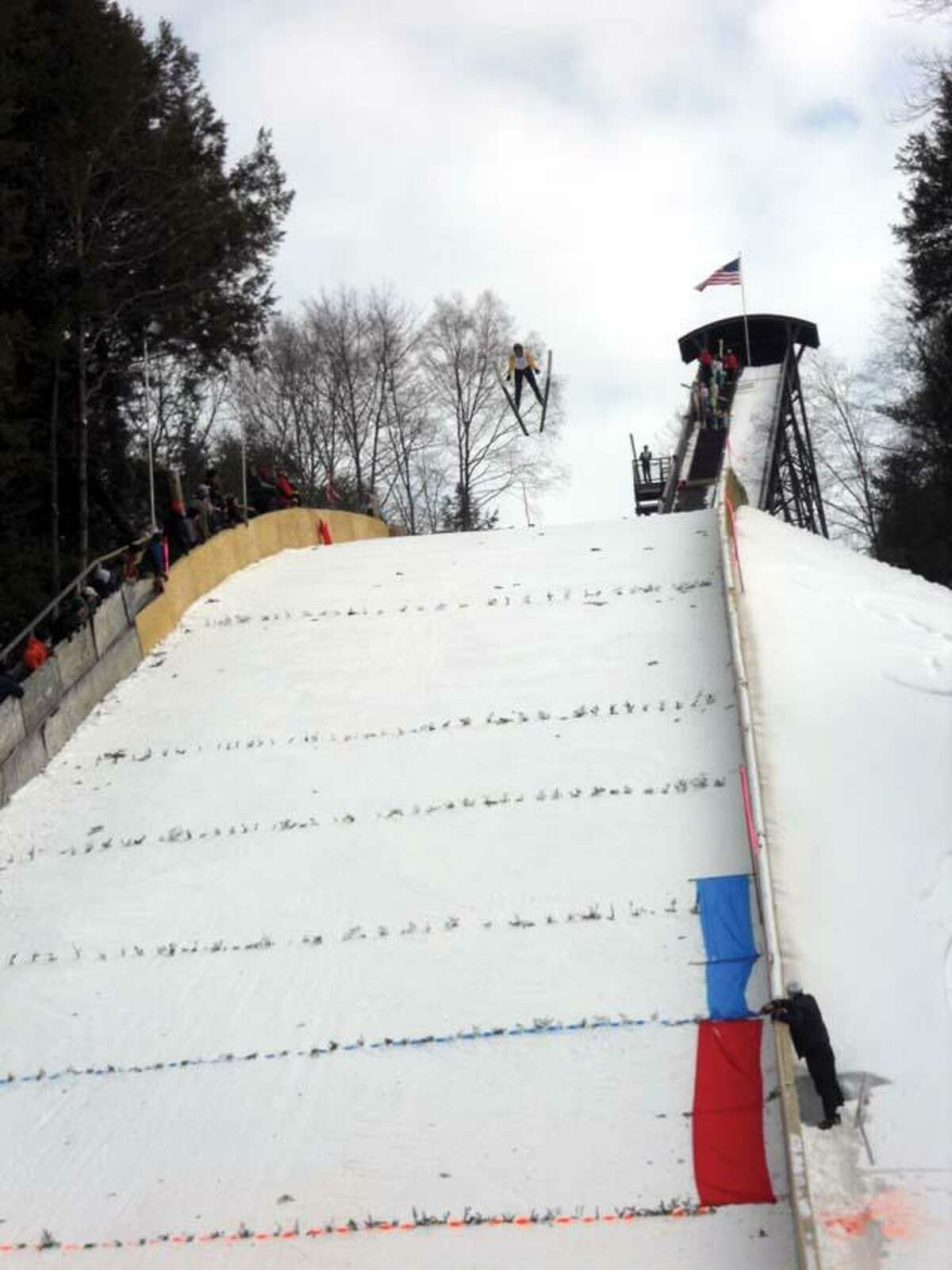 CHRIS RUELI/ Register CitizenA ski jumper soars thrugh the air before landing 70 meters from the take-off
