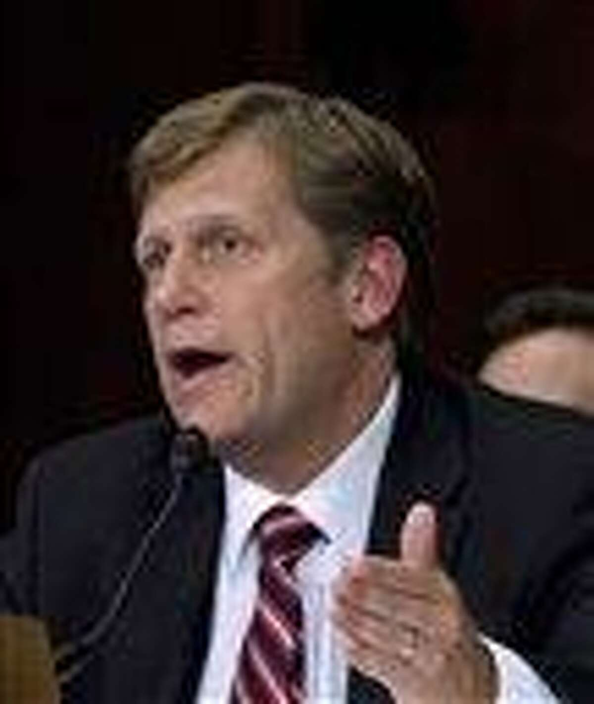In this 2011 file photo, then-US Ambassador to Russia-nominee Dr. Michael Anthony McFaul testifies on Capitol Hill in Washington. A U.S. official says the Obama administration has complained to Russia about harassment of the American ambassador and will raise concerns about his security. Associated Press