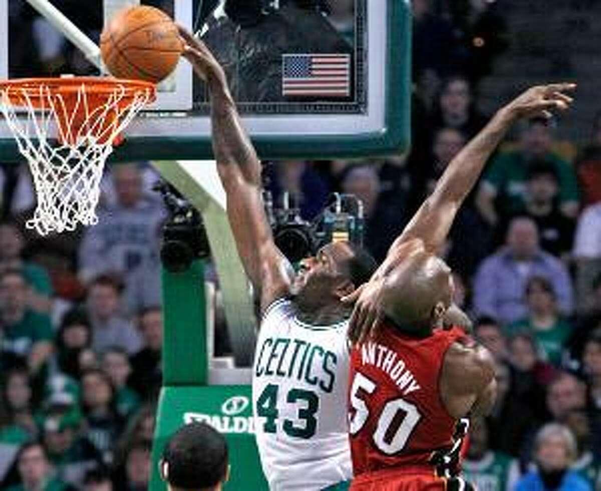 AP Boston Celtics center Kendrick Perkins (43) scores over Miami Heat center Joel Anthony (50) during the first half of Sunday's game in Boston. The Celtics won 85-82.